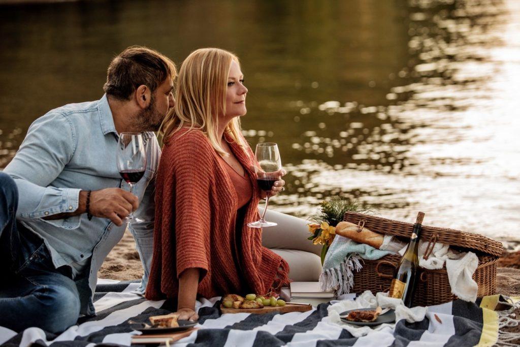 Anita and Dario having a picnic by the river